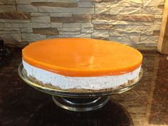 Cranberry cheese cake, sea-buckthorn glance on top of it.