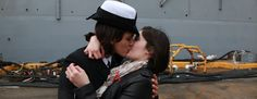 LOVE CONQUERS ALL   A Military First: Same-Sex Couple Kisses On Ship's Return