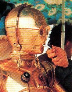 C3P0 Enjoys a cigarette break during filming.