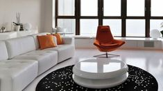 Awesome-Interior-living-room-design-of-contemporary-apartment-with-orange-armchair-and-white-leather-sectional-sofa-with-colorful-cushions-using-round-white-coffee-table-on-the-black-white-dot-rug-and-white-cabinet-for-interior-lighting-design-ideas – Pri Home Design Images, House Design Photos, Cool House Designs, Design Ideas, Zeitgenössisches Apartment, Apartment Interior Design, Living Room Interior, Living Rooms, Interior Decorating