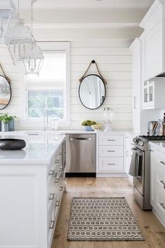 Black Rope Mirrors Hang From A Shiplap Wall On Either Side Of Kitchen Window Dressed