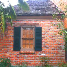 A. Hays Town, Architect. Burden Plantation. Orangerie side window. New Orleans old red bricks, cypress beam header, Hays Town Shutter green paint