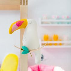 Cream Charlie Toucan Decoration by Scalae, available at Bobby Rabbit.