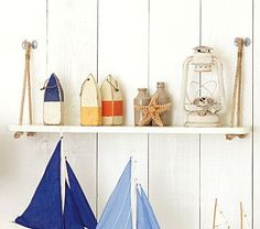 Love the nautical inspired shelves.  Another project I could make myself?