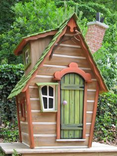 Cottage style playhouse with steam-bent wooden shingles, custom redwood windows and doors and handmade leaded glass windows. I searched for this on /images