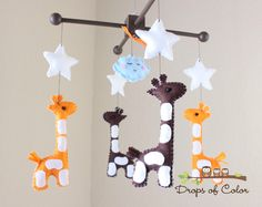 "Baby Mobile - Baby Crib Mobile - Nursery Giraffe Mobile - Safari Mobile ""Baby Giraffes"" (You Can Pick Your Colors) by dropsofcolorshop on Etsy https://www.etsy.com/listing/102398303/baby-mobile-baby-crib-mobile-nursery"