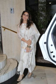 Sara Ali Khan and Amrita Singh look picture perfect as they get papped outside Manish Malhotra's house - HungryBoo Pakistani Formal Dresses, Indian Gowns Dresses, Long Dresses, Casual Dresses, Indian Wedding Outfits, Indian Outfits, Indian Attire, Indian Wear, Casual Indian Fashion