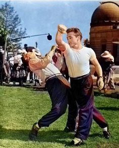 James Dean the Giant is shown by retired boxer Mushy Callahan some moves on the set of Rebel Without A Cause James Dean Photos, Male Icon, Rebel Without A Cause, Jimmy Dean, East Of Eden, Griffith Park, West Side Story, Famous Movies, My Favorite Image