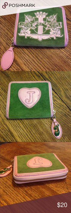 """Juicy Couture green and pink wallet Juicy Couture green and pink wallet , leather, zips around, inside has a snap pocket that says mad money, 3 slit pockets and 1 ID pocket inside, large money holder pocket, closed its 4.5""""across, 4""""high and 1"""" wide, open its 8"""" across, shows some wear on the leather but otherwise in good condition Juicy Couture Bags Wallets"""