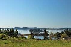***SOLD***$280,000*** WATER VIEW ACREAGE - San Juan Island.  3.5+ acres just outside the town limits. Beautiful south-facing pasture property with views of Griffin Bay and Dinner Island and only a short walk to a very nice public beach. Includes a well.  Adjacent 4+/- acre water view parcel available. MLS#497025   Coldwell Banker/San Juan Islands, Inc.  www.SamBuck.com