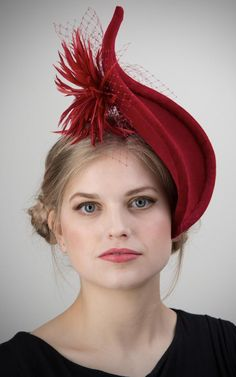 The elegant curved contours make for a unique hat will set you apart from the crowd. Made in red wool felt with a rich velvet trim and a large feather flower surrounded by veiling on the underside. Red Velvet Hat. Dark Red Velvet Mother of the Bride Hat. Winter Wedding Guest Hats. Hats for a Winter wedding Guest. Winter Wedding Fascinators . Winter Wedding Mother of the Bride Hats 2021. Autumn Wedding Guest Hats 2021. Ideas for Autumn Wedding Guests outfits. Fashionable hats for winter… Wedding Hats For Guests, Winter Wedding Guests, Winter Weddings, Autumn Wedding, Velvet Hat, Red Velvet, Winter Fashion Outfits, Fashion Ideas, Mother Of The Bride Hats
