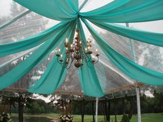 Clear Tent - #frametent #cleartent #fabricswags #chandelier #weddingdecor #MichiganWedding #OutdoorWedding #ColonialEvents