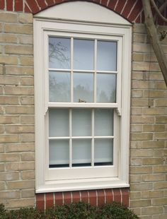 PVC Sash window with a cream timber effect finish