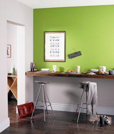 Kitchen breakfast bar painted with Crown Feature Wall in Easy Peasy (green)