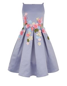 Florals go formal with our beautiful Ofressia dress for girls. With pretty flowers and leaves appliquéd at the waist, it's finished with a large bow and conc...