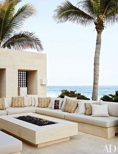 Cindy Crawford and Rande Gerber's outdoor living room at their Los Cabos, Mexico, home is clad in niwala limestone from Spain. The seating is topped by cushions clad in a Ralph Lauren Home fabric.