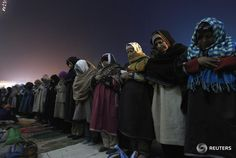 Kashmiri Muslim women offer prayers during the festival of Eid-e-Milad at Hazratbal shrine on a cold winter morning in Srinagar January 4, 2015. Thousands of Kashmiri Muslims on Sunday morning thronged to the shrine of Hazratbal, which houses a relic believed to be a hair from the beard of Prophet Mohammad, to celebrate Eid-e-Milad or the Prophet's birth anniversary. REUTERS/Danish Ismail
