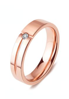 Crafted in luxurious 14k rose gold, this stately tungsten wedding band features  two crossed grooves. The elegant design is the perfect setting for its brilliant white cz diamond. This beautiful ring is available in 4mm and 5mm widths, making it perfect for women and men who want a matching set.