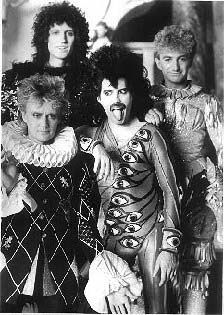 an amusing capture of Freddie with the rest of Queen.