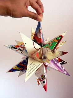 51 EPIC ways to recycle old Christmas cards. These Christmas card crafts are eco-friendly & a great way to create keepsakes of past holidays. Christmas Card Crafts, Christmas Star, Christmas Projects, Holiday Crafts, Holiday Fun, Christmas Holidays, Recycled Christmas Decorations, Recycled Christmas Cards, Oragami Christmas Ornaments