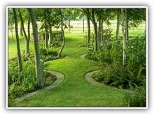 Serpentine Path - the bed edging would certainly help keep the grass out of the flowerbeds. This is really nice!