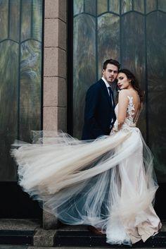 Windswept bride and groom captured by Baylee Dennis Photography