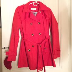 Calvin Klein red trench coat Red Calvin Klein trench coat. Size: Small. Tiny stain on back (see compared to Chapstick). Buttons slightly loosening but very much intact! So cute and great in the rain. Calvin Klein Jackets & Coats Trench Coats