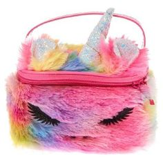 A furry rainbow unicorn makeup bag that is perfect for travelling and carrying all your cosmetic essentials. It features a top handle and a zipper closure Claire's Makeup, Girls Makeup, Rainbow Bag, Rainbow Unicorn, Unicorn Makeup, Unicorn Hair, My Sister Birthday, Flower Hair Clips, Girls Accessories