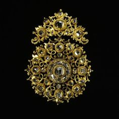 Pendant      Place of origin:      Spain (made)     Date:      late 17th century (made)     Artist/Maker:      unknown (production)     Materials and Techniques:      Table-cut and rose-cut diamonds set in gold openwork
