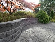 A Bayfield™ retaining wall accompanied by circle kit pavers provides a welcoming place to sit in Sweden. Sidewalk, Around The Worlds, Patio, Landscape, Wall, Outdoor Decor, Inspiration, Beautiful, Design