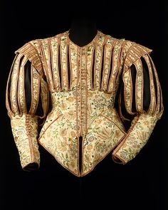 ca. 1620s - Doublet. French. Silk.  This extraordinary doublet is one of only two surviving examples of its type from the 1620s. The only other is in the collection of the Victoria and Albert Museum in London. Made of luxurious silk embellished with pinking and decorative slits, this doublet followed a fashion that existed barely five years. Pinking, or the intentional slashing of fabric, was a popular decorative technique used to reveal colorful linings, shirts, and chemises.