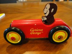 Curious George toy car and book