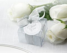 Simple yet elegant. Crystal Clear box with a silver ribbon makes the perfect wedding favor. http://www.clearbags.com/box/food/shallow