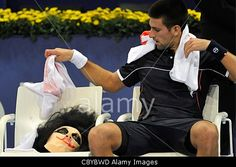 Serbia's Novak Djokovic with his halloween mask during his first round match against Belgium's Xavier Malisse at the Swiss Indoors tennis tournament at the St. Jakobshalle in Basel, Switzerland, 01 November 2011.© epa european pressphoto agency b.v. / Alamy