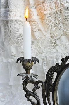 Candle and white lace