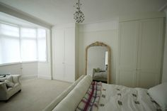 full height Wardrobes both alcoves, simple shaker