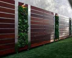 Elegant wood and stainless steel privacy fence.