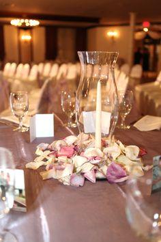 Pelazzio Full Service Wedding Venue can help create the ceremony, reception, or both! #Houston #Reception #Wedding #Tables #Chairs #Setup #Venue #Decor #Centerpiece #Inspiration #White #Ivory #Pink #Purple #Lavender #Rose Petals #Hurricane Lamp #Candle www.pelazzio.com