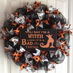 This Halloween mesh wreath has a cute orange and black diamond patterned sign that says You Say Im A Witch Like Its A Bad Thing centered in