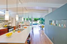 Love how light and bright the kitchen is, especially the touch of blue/aqua in there.  Want to see how to include the clerestory windows into a future house.