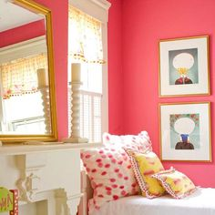 Hot pink walls? Sure! Anything goes in this circus-inspired bedroom. A faux fireplace mantel provides bedside shelf space, and a joyous jumble of colors and patterns give this room spirit and individuality