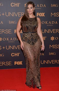 Golden girl: Ashley Graham dazzled on the red carpet at the Miss Universe pageant in the Philippines, wearing a sheer beaded dress
