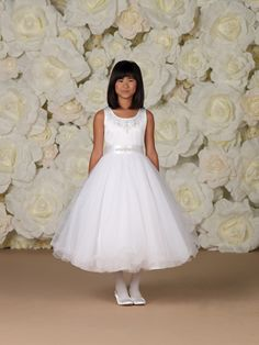 Joan Calabrese makes memorable Communion Dresses. Available in sizes 6-14. #communion #dress #flowergirl magicmomentscollections.com