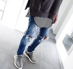 ripped jeans. stripes. sneakers.