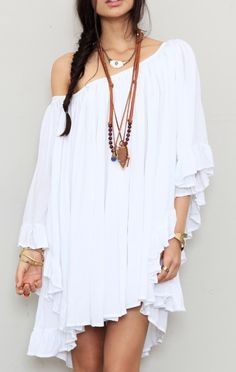 Cute little swimsuit coverup that could double as a day dress ... perfect for going from the beach to a café in Santorini