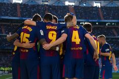 """Barcelona's players celebrate after Argentinian forward Lionel Messi scored during the Spanish League """"Clasico"""" football match Real Madrid CF vs FC Barcelona at the Santiago Bernabeu stadium in Madrid on December 23, 2017.  / AFP PHOTO / CURTO DE LA TORRE"""