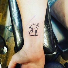 16 Adorable, Tiny Elephant Tattoos That You'll Never Forget
