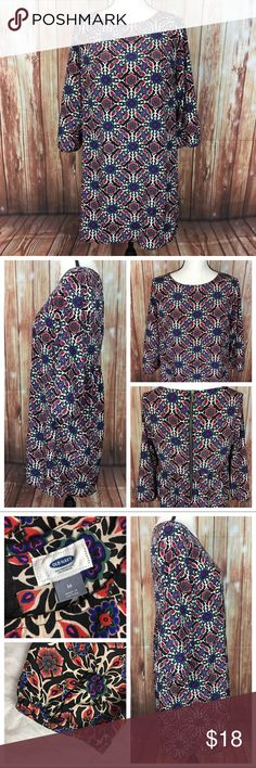 "Old Navy Kaleidoscope Print Tunic Dress Top Size: Women's Medium  Brand: Old Navy  Style # 145463-01  Condition: Excellent, pre-owned.   Black, white, red orange, purple & blue kaleidoscope print tunic top.  3/4 length, wide sleeve. Exposed bronze zipper in back.   Fabric: 100% Polyester  Measurements: 20"" bust from underarm to underarm, 21"" hip laid flat at widest point, 33"" length from shoulder to hem, 18"" sleeve length from shoulder to cuff Old Navy Tops Tunics"