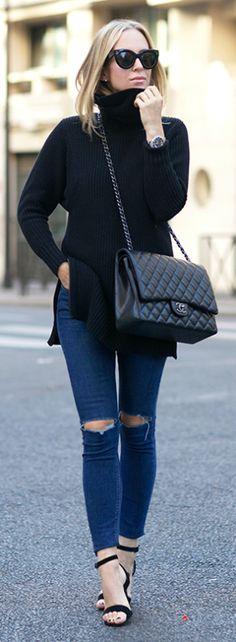 Helena Glazer looks effortlessly chic in a simple black turtleneck jumper and skinny jeans.  Sweater: Banana Republic, Denim: Topshop, Shoes: Steven Madden.