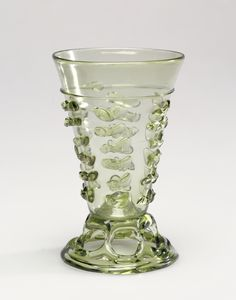 Footed Beaker; Unknown; Lower Rhineland (possibly), Germany; 1500 - 1550; Free-blown pale yellow-green glass with applied decoration; 11.9 cm (4 11/16 in.); 84.DK.532